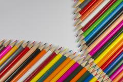 Colorful cedar wooden pencils in zipper shape. - stock photo