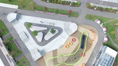 4k aerial overhead skatepark with skateboarder Stock Footage