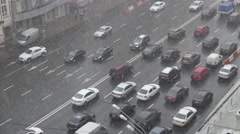 Traffic on highway during winter snow storm Stock Footage