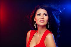 beautiful sexy woman in red at nightclub - stock photo