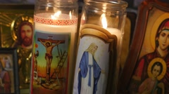 4K Christian Icon And Candle Burning in Church Stock Footage