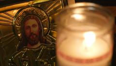 4K Jesus and Candle Flame Closeup Dramatic Focus Shift - stock footage