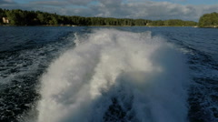 Powerful wake from power boat in Stockholm archipelago Stock Footage