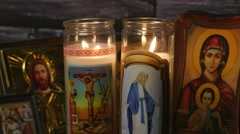 4k Jesus and Mother Mary Candles and Icones Stock Footage