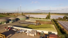 AERIAL: Biogas plant with 3 fermenters in germany - stock footage