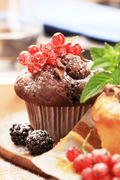 Tasty muffins garnished with berry fruit Stock Photos
