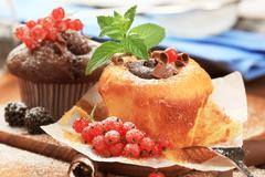 Tasty cupcakes garnished with fresh berry fruit - stock photo