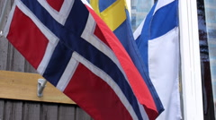 Nordic flags in front of rustic club house Stock Footage