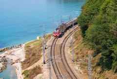 Train travels along the seashore - stock photo