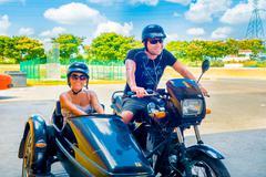 Stock Photo of HAVANA, CUBA - SEPTEMBER 13, 2015: Couple of tourists in custom chopper sidecar