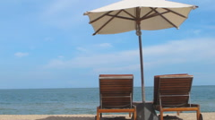 Bed umbrella on the beach Stock Footage