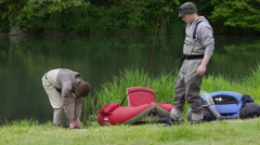 Fly fishermen prepare for fishing Stock Footage