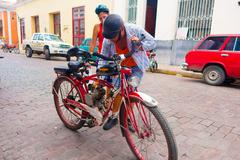 CAMAGUEY, CUBA - SEPTEMBER 4, 2015: home made pedal assisted gas powered bicycle - stock photo