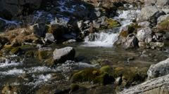Small river with waterfalls in mountains Stock Footage