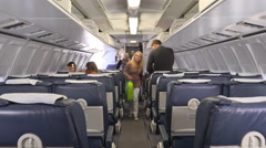 Inside of aircraft as passengers are boarding Stock Footage