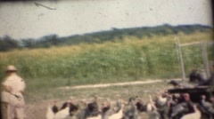 1948  ,Grandma and granddaughters hand feeding turkeys Stock Footage