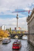 Tourist boats on the Spree river, Berlin city - stock photo