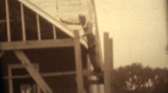 1946, Man building a new stick frame house Stock Footage