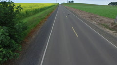 Aerial shot of country road Stock Footage