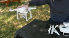 Man preparing drone for flight Stock Footage