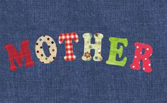 Mother- lettering of handmade paper letters over white background Stock Photos