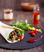 Beef fajitas roll with hot peppers, salad, corn - stock photo