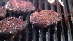 Hamburgers on grill in slow motion, shot on Phantom Flex 4K Stock Footage
