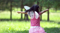 Girl in fairy princess costume spins holding dandelions, shot on Phantom Flex 4K - stock footage