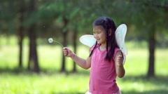 Girl in fairy princess costume waving dandelions, shot on Phantom Flex 4K - stock footage
