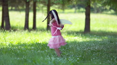 Girl in fairy princess costume spinning with flowers, shot on Phantom Flex 4K - stock footage