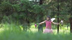 Girl in fairy princess costume running in grass, shot on Phantom Flex 4K - stock footage