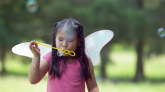 Girl in fairy princess costume blowing bubbles, shot on Phantom Flex 4K - stock footage