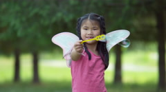 Girl in fairy princess costume blowing bubbles, shot on Phantom Flex 4K Stock Footage