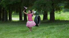 Girl in fairy princess costume on tire swing, shot on Phantom Flex 4K - stock footage