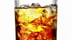 Rotating cola with ice and bubbles in a glass, Isolated on white Stock Footage
