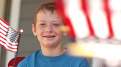 Boy waving American flag, shot on Phantom Flex 4K - stock footage
