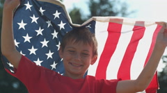 Boy waving American flag, shot on Phantom Flex 4K Stock Footage