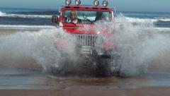 4x4 off road vehicle driving through water in slow motion, shot on Phantom Flex Stock Footage