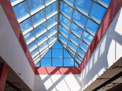 Upward view on the triangular glass roof - stock photo