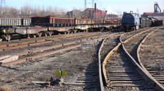 An industrial railyard with flatcars and tankers. Stock Footage