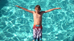 Boy splashing into pool in slow motion, shot on Phantom Flex 4K - stock footage