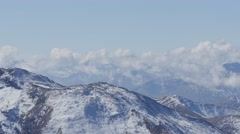 Fast motion Snowy alpine summits in austria - stock footage