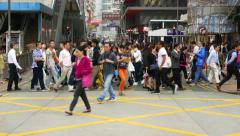 Crowd rush through crosswalk, glide dolly parallel shot, citizens walk - stock footage