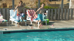 Boys jumping into pool, shot on Phantom Flex 4K Stock Footage
