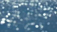 Stock Video Footage of Sun Reflecting in Blue Water, Defocused