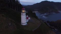 Aerial shot of Heceta Head Lighthouse at sunset, Oregon - stock footage