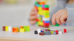 Child playing with lego bricks, close up Stock Footage
