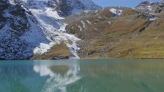 Alpine Lake Snowy Mountains Stock Footage
