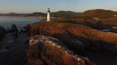 Aerial view of Yaquina Bay Lighthouse at sunset, Newport, Oregon Stock Footage