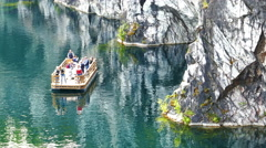 Passage-boat with Tourists on Marble Canyon Ruskeala Stock Footage